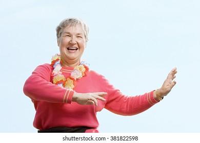 Woman wearing flower garland and dancing