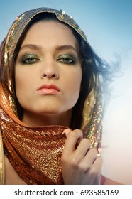 Woman wearing glamorous make up and sequin hoodie