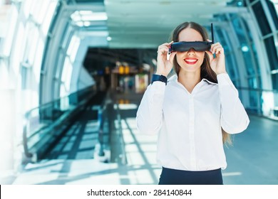 woman wearing goggles in futuristic interior -  wearables concept