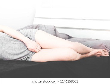 woman wearing gray clothes on bed,She have bladder pain,soft and selective focus,health care concept.