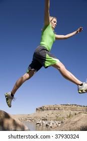 Imágenes, fotos de stock y vectores sobre Woman Leaping Rock