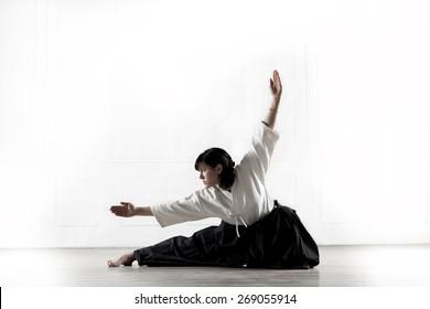 woman wearing a hakama holds a kung fu