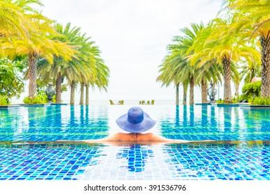Woman wearing hat in the hotel pool resort