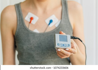 Woman wearing holter monitor device for daily monitoring of an electrocardiogram. Treatment of heart diseases