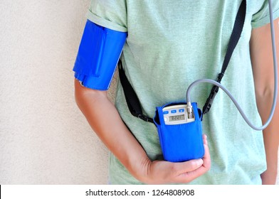 Woman wearing holter monitor device for daily monitoring of an electrocardiogram. Health care and disease prevention.