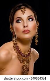 Woman wearing Indian jewelry.