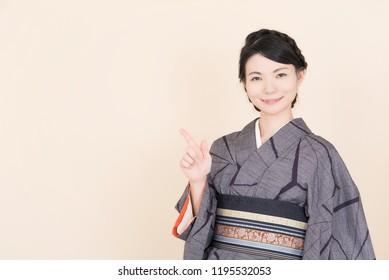 "woman wearing Japanese traditional national costume ""kimono"""