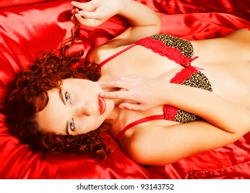 woman wearing lingerie laying on bed