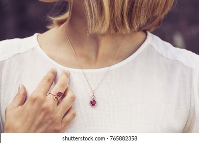 Woman wearing luxury necklace and ring