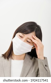A woman wearing a mask due to poor physical condition