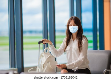 Woman wearing a mask for prevent virus with baggage in international airport. Protection against Coronavirus and gripp