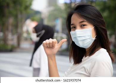 woman wearing mask, stopping virus outbreak; concept of new norm health care, coronavirus disease outbreak control, new normal social distancing, personal distance, physical distancing normal practice
