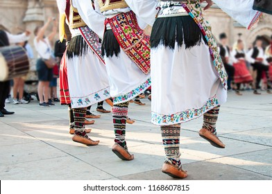 Woman wearing one of the traditional folk costume from the Republic of Serbia with a violin