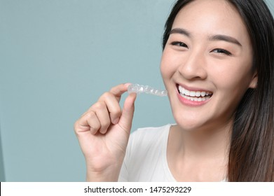 Woman wearing orthodontic silicone trainer. Mobile orthodontic appliance for dental correction. tooth whitening systems.