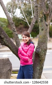 Woman wearing a pink jacket
