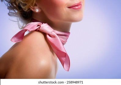 Woman wearing pink scarf.