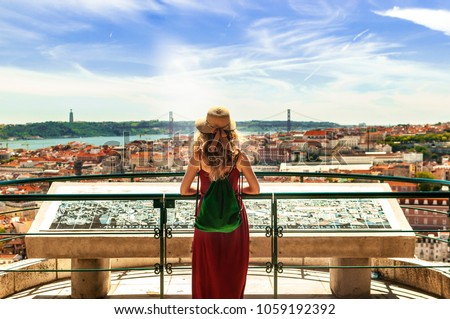 Woman wearing portuguese flag colors in Lisbon, Portugal