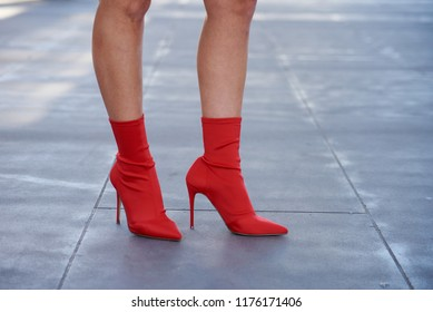 Woman Wearing Red Sock Ankle Boots On Pavement