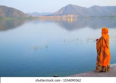 A woman wearing a saree next to Man Sagar Lake in Jaipur, Rajasthan