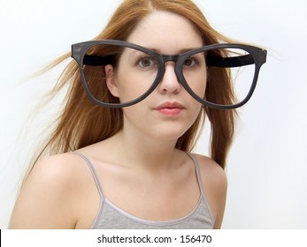 Woman wearing silly oversized glasses.