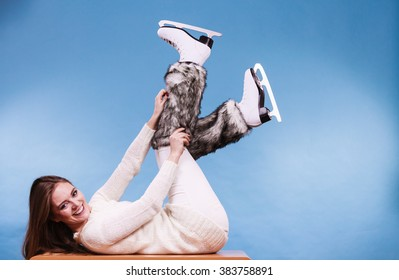 Woman wearing skates fur warm socks. Girl getting ready for ice skating. Winter sport activity. Studio shot on blue