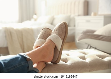 Woman wearing soft comfortable slippers at home, closeup