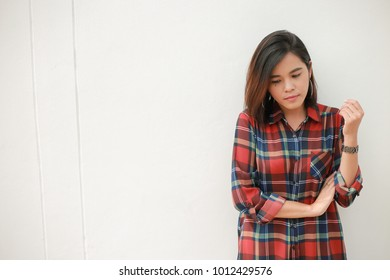 Woman wearing a striped shirt against a white backdrop.