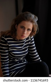 WOman wearing striped t-shirt.real adult woman. photo without retouch