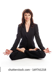 Woman wearing a suit in the Lotus yoga position. Isolated on white.