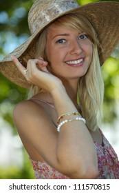 Woman wearing summery straw hat