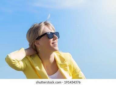Woman wearing sunglasses in bright sun