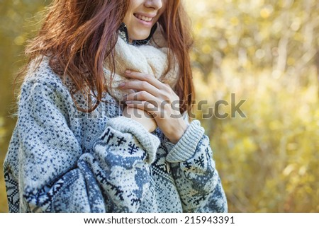 woman wearing sweater (soft focus on her hands)