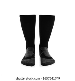 Woman wearing thermal socks on white background, closeup of legs. Winter sport clothes