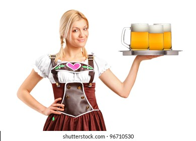 A woman wearing traditional costume and holding three beer glasses isolated on white background