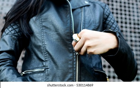 Woman wearing trendy black leather jacket with zipper