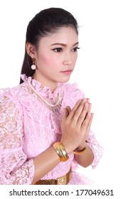 woman wearing typical thai dress pay respect isolated on white background, identity culture of thailand