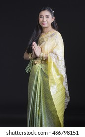 woman wearing typical thai dress with black background, identity culture of thailand