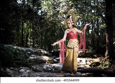 woman wearing typical thai dress with nature on background, identity culture of thailand,Thailand Dancing art,Thai Classical Dance,(Rum thai) is the main dramatic art form of Thailand.