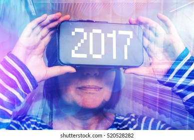 Woman wearing virtual reality headset with number 2017, happy new year