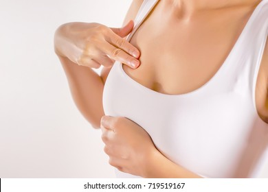 Woman Wearing A White Tank Top Checking Her Breast, Breast Self-Exam (BSE), How do I check breast concept, Breast Cancer Awareness