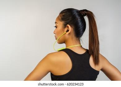 woman wearing a wireless headphone facing back