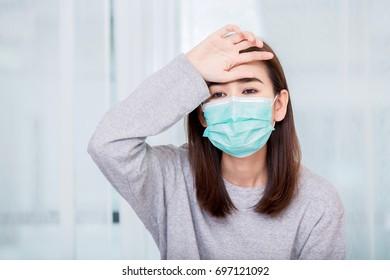 A Woman wears a mask.