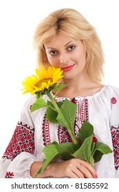 Woman wears Ukrainian national dress is holding a sunflower