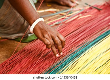 Woman weaving with bamboo made thinner sticks unique photo