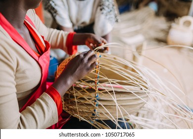 woman weaving a basket in Rwanda, Africa