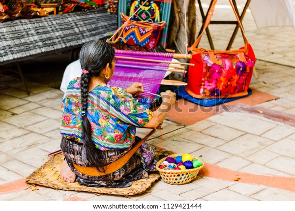 Woman weaving in an old village in Guatemala.   Traditional waver from Guatemala.