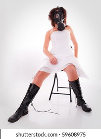Woman in Wedding Dress with Gas Mask and Boots on