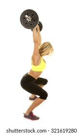 a woman with a weight above his head doing a squat.