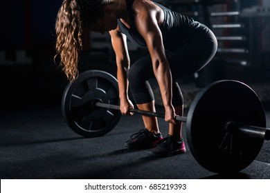 Woman weightlifting on training