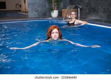 Woman in wellness and spa swimming pool.
